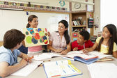 Schoolchildren in class — Fotografia Stock