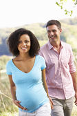 Expectant couple outdoors — Stock Photo