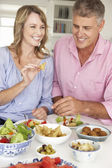 Mid age couple enjoying meal — Stock Photo