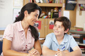 Teacher and schoolboy — Stock Photo