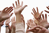 People's hands in air — Stock Photo