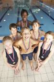 Winning swimming team — Stock Photo