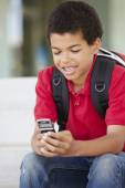 Boy with phone at school — Stock Photo