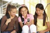 Pre teen girls in school — Stock Photo