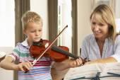 Young boy playing violin — Stock Photo