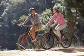 Couple on bike ride — Stock Photo