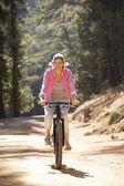Woman on bike ride — Foto de Stock