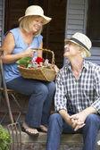 Senior couple on veranda — Stock Photo