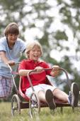 Boys playing with go-kart — Stockfoto