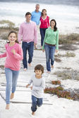 Family walking by sea — Stock Photo