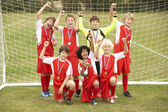 Winning junior soccer team — Stockfoto