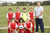 Junior soccer team and coach — Stock Photo