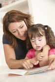 Mother and Downs Syndrome girl — Stock Photo