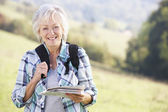 Senior woman on  walk — Stock Photo