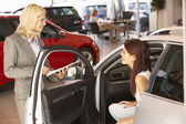 Young woman buying car — Stock Photo