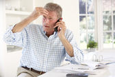 Man with household bills — Stock Photo