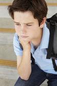 Unhappy  boy at school — Stockfoto