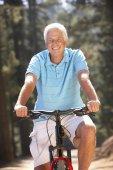 Senior man on bike ride — Foto de Stock