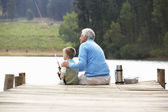 Senior man and grandson fishing — Stock Photo