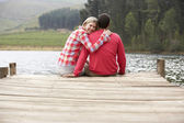 Romantic couple on a jetty — Stockfoto
