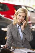 Woman in car showroom — Stock Photo