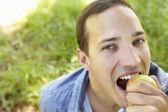 Man eating apple — Stock Photo