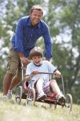 Father and son with go-kart — Stock Photo