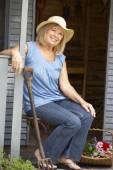 Senior woman on veranda — Stock Photo