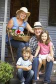 Senior couple  with grandchildren — Stock Photo