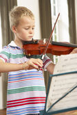 Young boy playing violin — Stock Photo