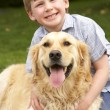 Young boy with golden retriever — Stock Photo #61030063
