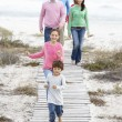 Family walking by sea — Stock Photo #61030117