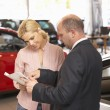 Woman buying a car — Stock Photo #61030531