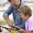 Man fishing with grandson — Stock Photo #61030841