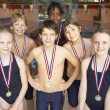 Winning swimming team — Stock Photo #61030887