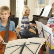 Children playing musical instruments at home — Stock Photo #61031373