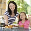 Mother and daughter eating breakfast — Stock Photo #61031577