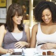 Pregnant women sitting in cafe — Stock Photo #61031747