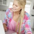 Girl doing homework with laptop — Stock Photo #61031955