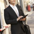 Businessman standing at bus stop — Stock Photo #61032405