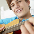 Boy playing acoustic guitar — Stock Photo #61032505