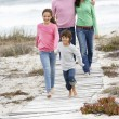 Family walking by sea — Stock Photo #61032549