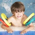 Boy in swimming pool — Stock Photo #61032821