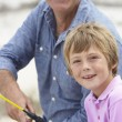 Man fishing with grandson — Stock Photo #61033361