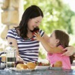 Mother and daughter eating breakfast — Stock Photo #61033391