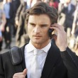Male commuter  using phone — Stock Photo #61033439