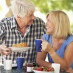 Senior couple eating — Stock Photo #61033459