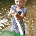 Girl with fishing net — Stock Photo #61033555