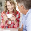 Mid age couple having coffee — Stock Photo #61033583