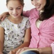 Mother and daughter reading — Stock Photo #61033707